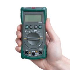 Digital multimeter in technicians hand
