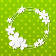 Paper flowers frame on green background