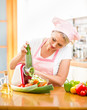 woman cutting vegetables with device in kitchen