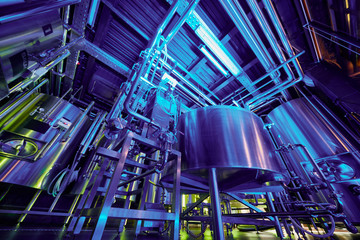 Brewing equipment at hall of microbrewery, low angle view