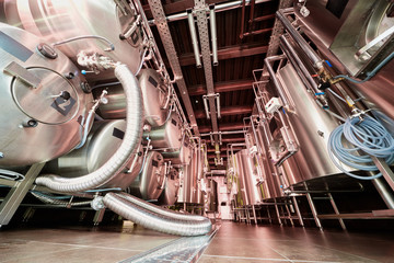 Tanks at microbrewery, low angle view