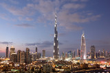 Fototapety Burj Khalifa and Dubai Downtown at dusk. United Arab Emirates