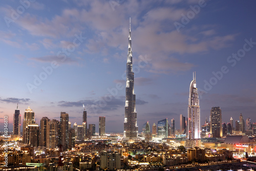 Aluminium Dubai Burj Khalifa and Dubai Downtown at dusk. United Arab Emirates