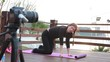 Young beautiful woman doing sports stretching exercise outdoors