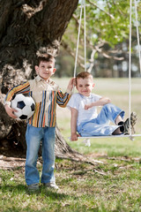 Children on a swing on a nature