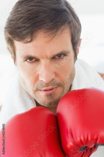 Close-up portrait of a determined male boxer