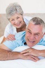 Loving senior couple relaxing in bed