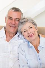 Affectionate senior couple smiling together