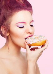 girl eating a donut with icing