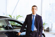Businessman near car