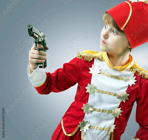 gun in the hands of a child
