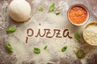 Pizza word written on table