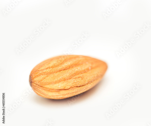 one almond closeup isolated on white background