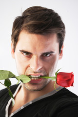 Man with a red rose in his mouth