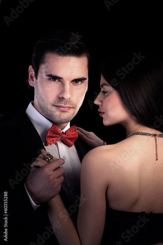 Couple in love, black background