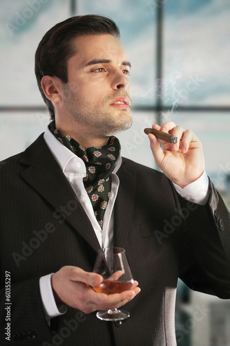 Man smoking cigar and drinking cognac