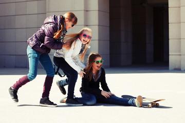 Group of teenage girls with skateboard