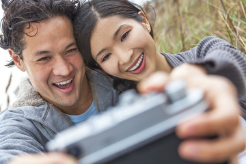 Asian Man Woman Couple Taking Selfie Photograph