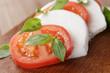 caprese salad made on cutting board