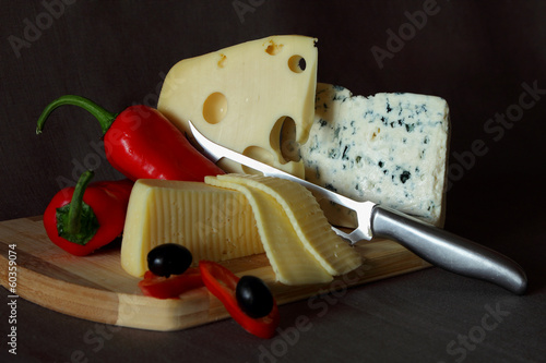Blue cheese,cheese with holes, red pepper and knife