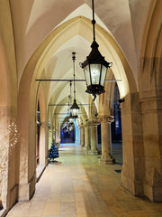 Gothic arcades Sukiennice by night, Krakow, Poland