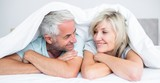 Close-up of a mature couple lying in bed