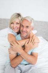 Portrait of a loving mature couple in bed