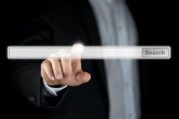 Businessman pushing a blank search bar