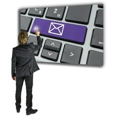Businessman sending an email message