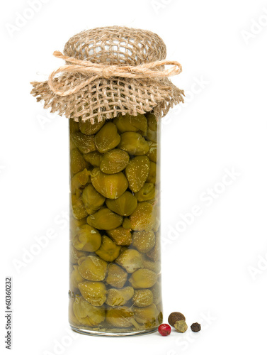 capers in a glass jar isolated on white