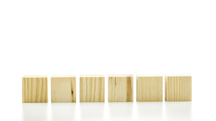 Row of six blank wooden blocks