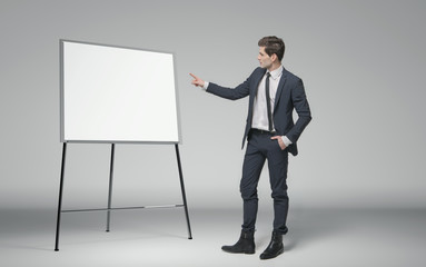 Young businessman making a lecture about business