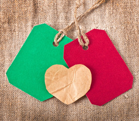 Valentine and the price tag on the background of old cloth