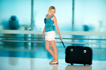 beautiful girl with big suitcase