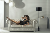 Sensual brunette lady lying at luxury couch