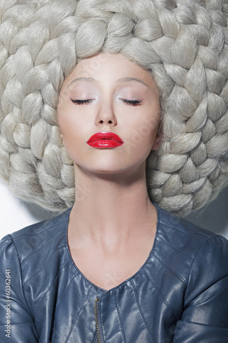 Fantasy. Creativity. Trendy Woman in Futuristic Wig with Braids
