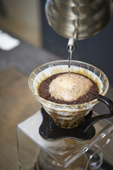 Barista brewing a cup full