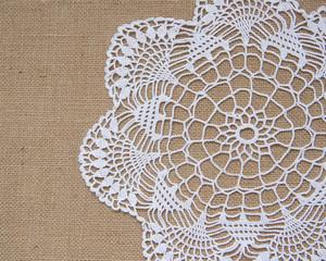 Crochet doily over burlap