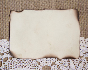 Burned paper card over crochet doily and burlap
