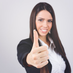 Gorgeous businesswoman showing thumb up
