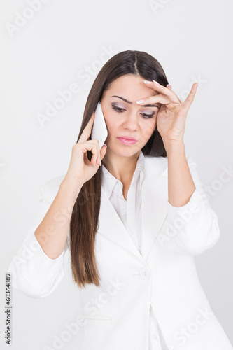 Beautiful businesswoman having a stressful phone call