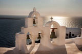 Traditional white bell tower at Oia, Santorini in Greece