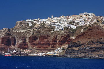 The old harbor in the Amaudi bay and town Oia on Santorini