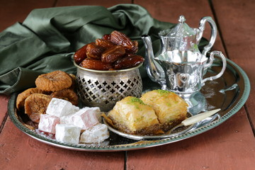 Assorted eastern sweets - baklava, dates, turkish delight