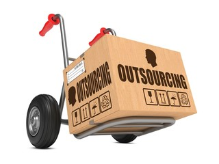 Outsourcing - Cardboard Box on Hand Truck.