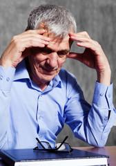 elderly stressed businessman