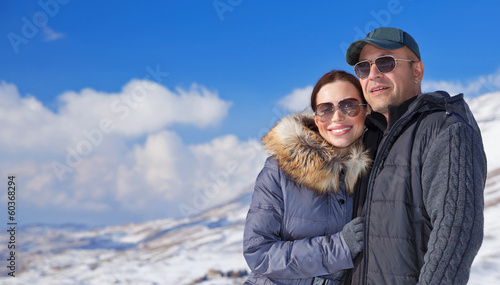 Happy travelers in snowy mountains