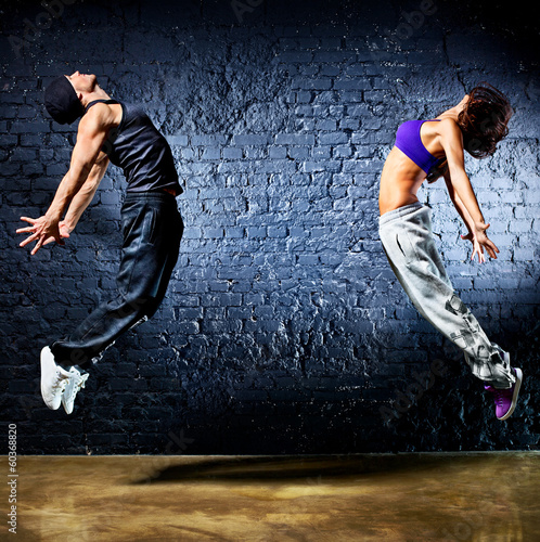 Young dancer couple jumping