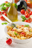 Farfalle with tomato and basil