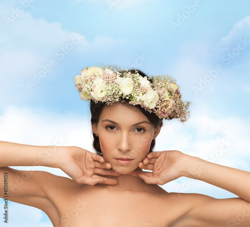 beautiful woman wearing wreath of flowers